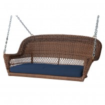 Honey Resin Wicker Porch Swing with Midnight Blue Cushion