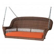 Honey Resin Wicker Porch Swing with Orange Cushion